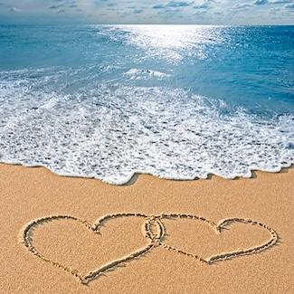 Love hearts drawn in the sand on Daytona Beach at Emerald Shores Hotel