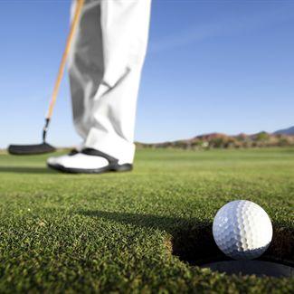 Guy makes a putt at a Daytona Beach golf course near out hotel