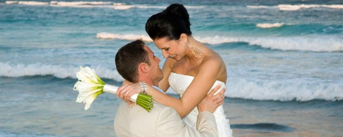 A couple celebrates after a beautiful oceanfront wedding in Daytona Beach